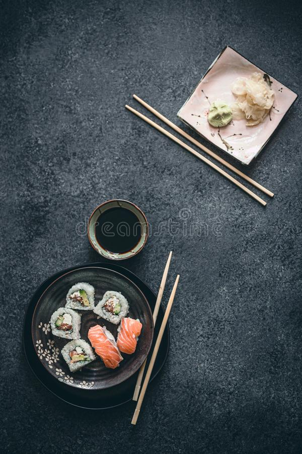Japanese sushi rolls and sashimi with raw salmon, rice. Ginger and wasabi and soy sauce stock photos