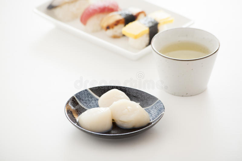 Japanese Sushi and Sashimi - Scallop and Green Tea. Japanese Sushi and Sashimi -- Scallop and Green Tea stock images
