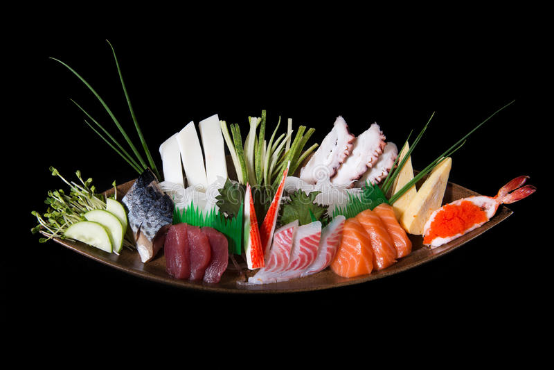 Japanese sushi sashimi. Japanese sushi, seafood, salmon fresh squid, salmon vegetalbe green fresh, shirmp, sashimi stock photos