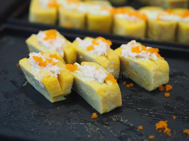Japanese sweet egg topped with salad dressing and Shrimp eggs, Nigiri Sushi food. Closeup Japanese sweet egg topped with salad dressing and Shrimp eggs, Nigiri royalty free stock image