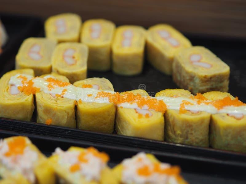 Japanese sweet egg topped with salad dressing and Shrimp eggs, Nigiri Sushi food. Closeup Japanese sweet egg topped with salad dressing and Shrimp eggs, Nigiri stock images