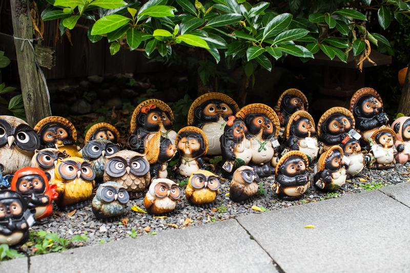 Japanese Tanuki statue in a traditional garden in Kyoto, Japan. The Japanese raccoon dog also known as tanuki  in Japanese, is a subspecies of the Asian raccoon royalty free stock photography