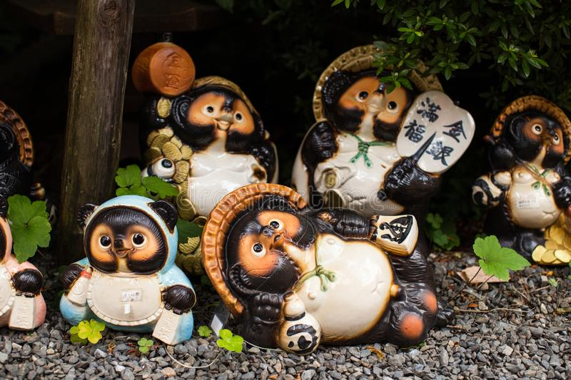 Japanese Tanuki statue in a traditional garden in Kyoto, Japan. The Japanese raccoon dog also known as tanuki  in Japanese, is a subspecies of the Asian raccoon stock photos