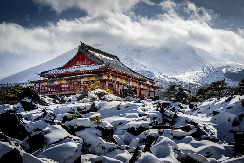 Lava Temple in the snow. Japanese temple in winter and snow Mt Asama royalty free stock images