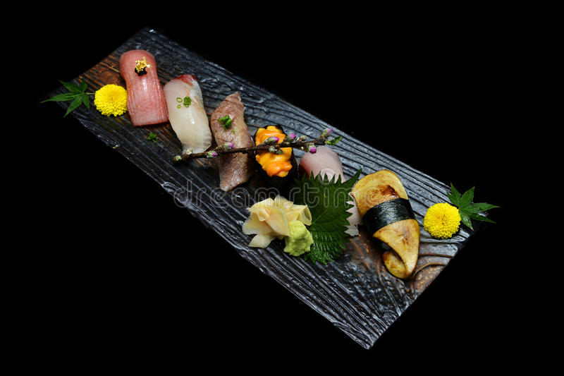 Japanese tradition food. Exclusive premium Sushi set on wooden plate stock photo