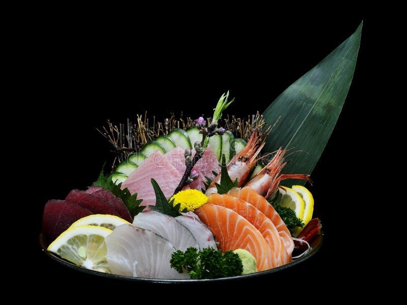 Japanese tradition food. Various medium Sashimi set on ice bowl. Japanese tradition food. Various medium Sashimi set on ice bowl with black isolated background royalty free stock images