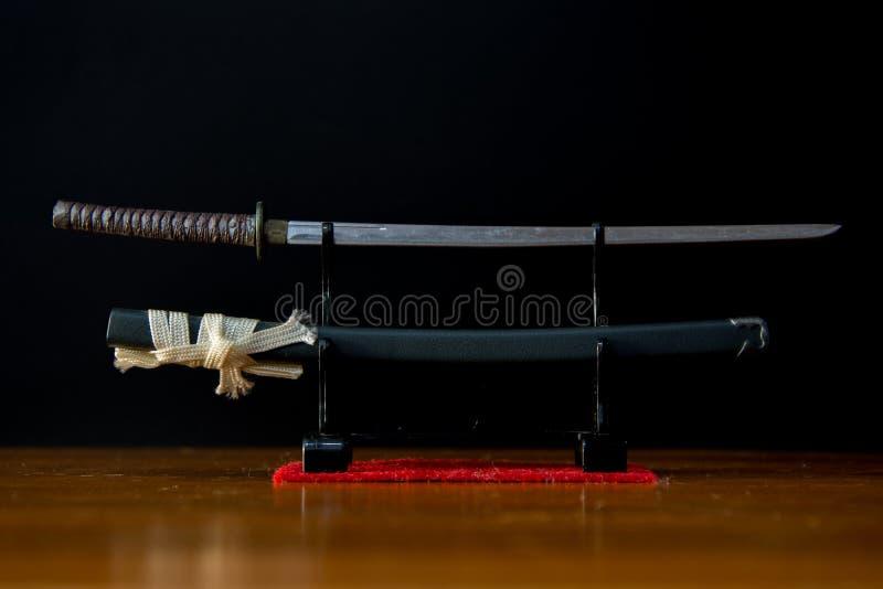 Japanese Tradition Samurai Sword on Black Background royalty free stock photography
