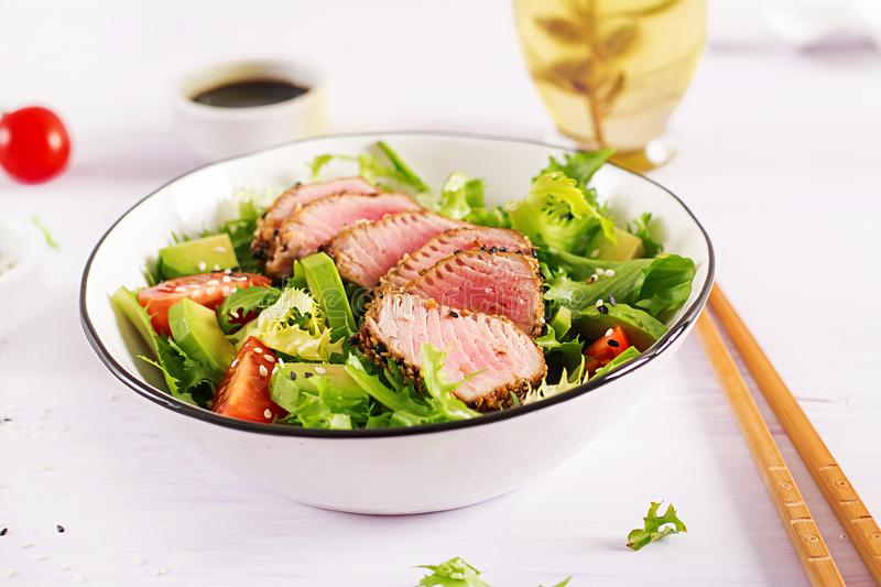 Japanese traditional salad with pieces of medium-rare grilled Ahi tuna stock image