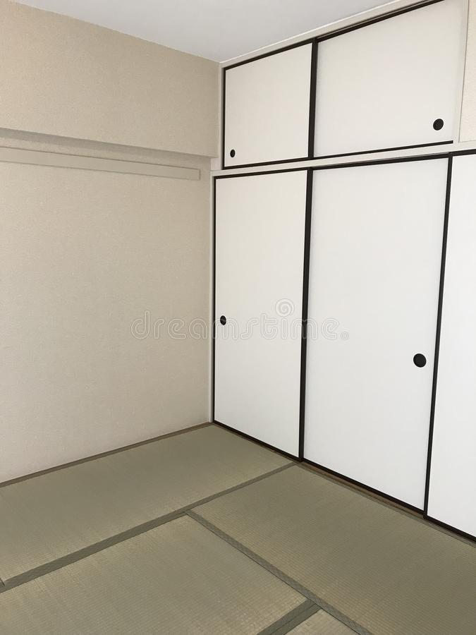 Japanese traditional tatami floor mat room. In vertical frame royalty free stock photography