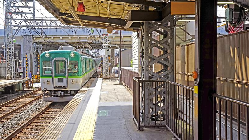 Japanese train, railway track, station in Japan Tokyo downtown. The green Japanese train, railway track and station in Japan Tokyo downtown stock image