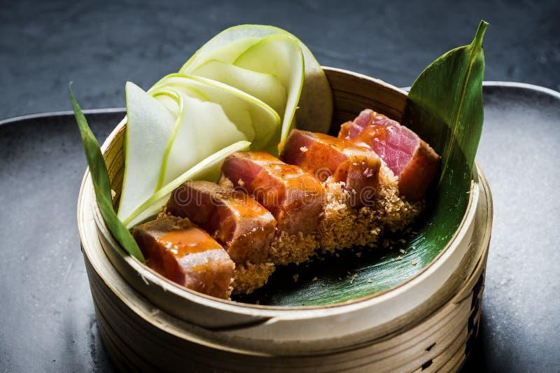 Japanese tuna sashimi, dark background, top view. Japanese tuna sashimi, dark background, top view royalty free stock photos