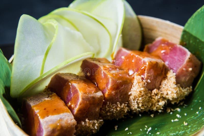 Japanese tuna sashimi, dark background, top view. Japanese tuna sashimi, dark background, top view stock images