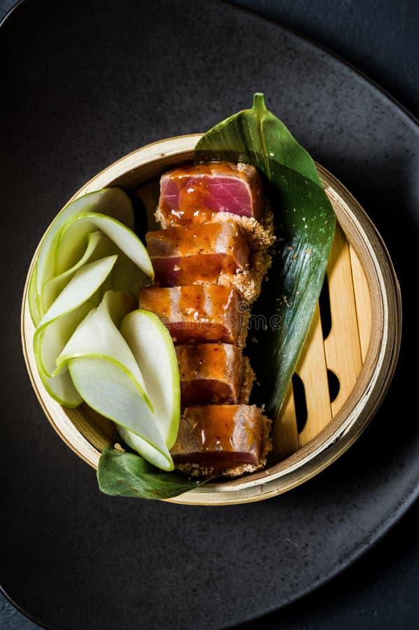 Japanese tuna sashimi, dark background, top view. Japanese tuna sashimi, dark background, top view royalty free stock image
