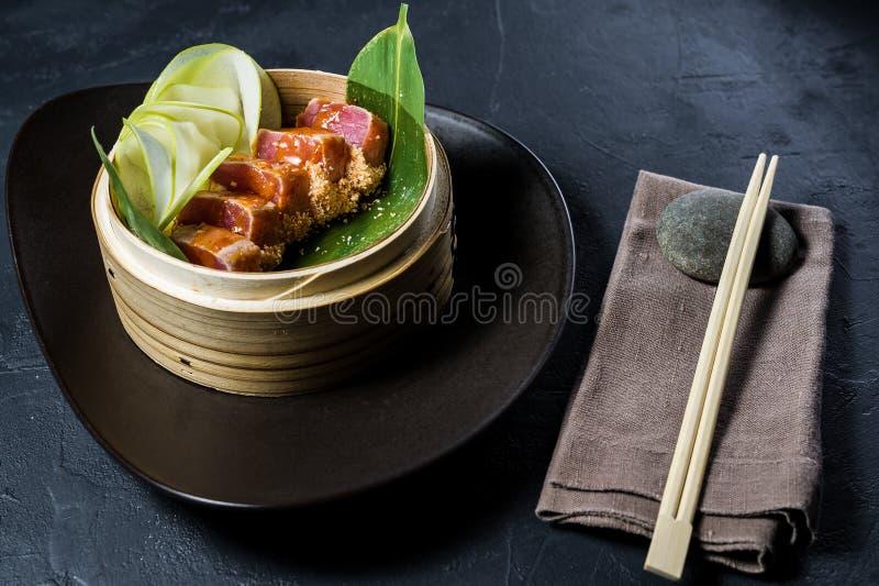 Japanese tuna sashimi, dark background, top view. Japanese tuna sashimi, dark background, top view royalty free stock photo