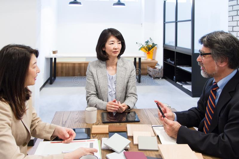 Japanese woman attending team meeting as a leader. Japanese woman, meeting with team member royalty free stock images