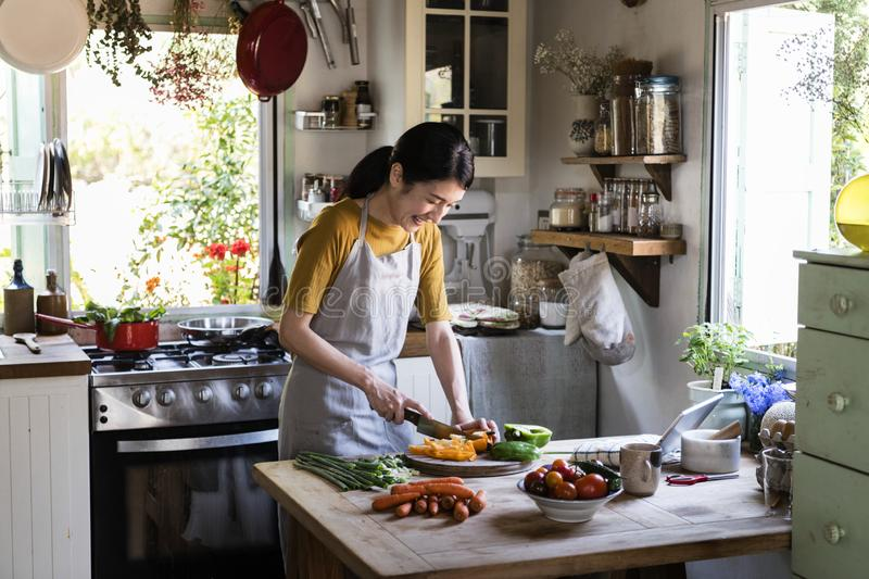 Japanese woman cooking in a countryside kitchen stock images