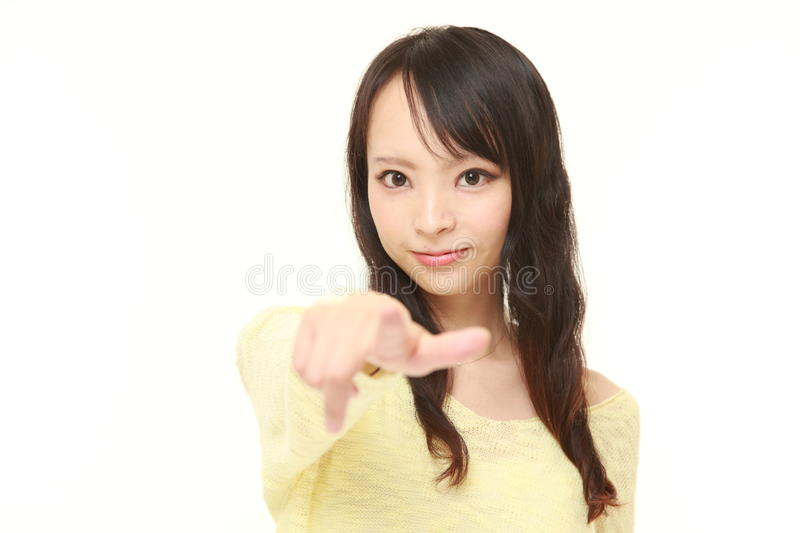 Japanese woman decided. Studio shot of young Japanese woman's portrait on white background stock photography