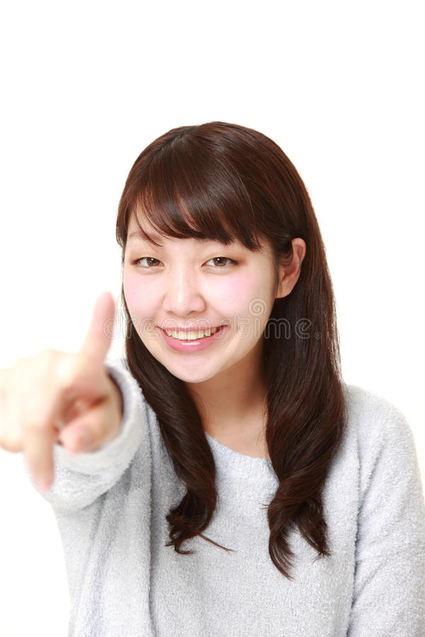Japanese woman decided. Studio shot of young Japanese woman on white background royalty free stock image