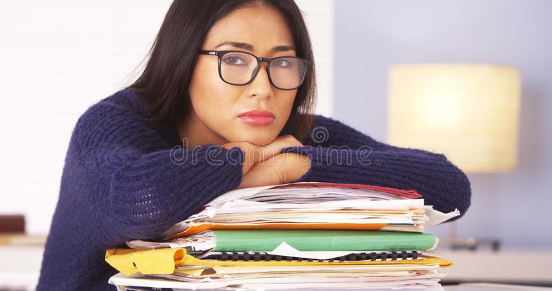 Japanese woman fed up with paperwork. Woman fed up with paperwork stock photography