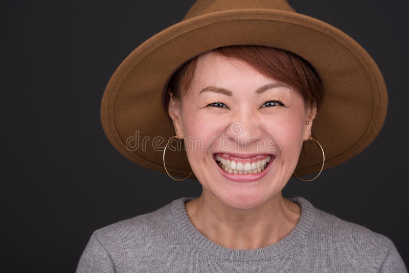 Japanese Woman Headshot. A headshot of a smiling middle aged Japanese woman stock images