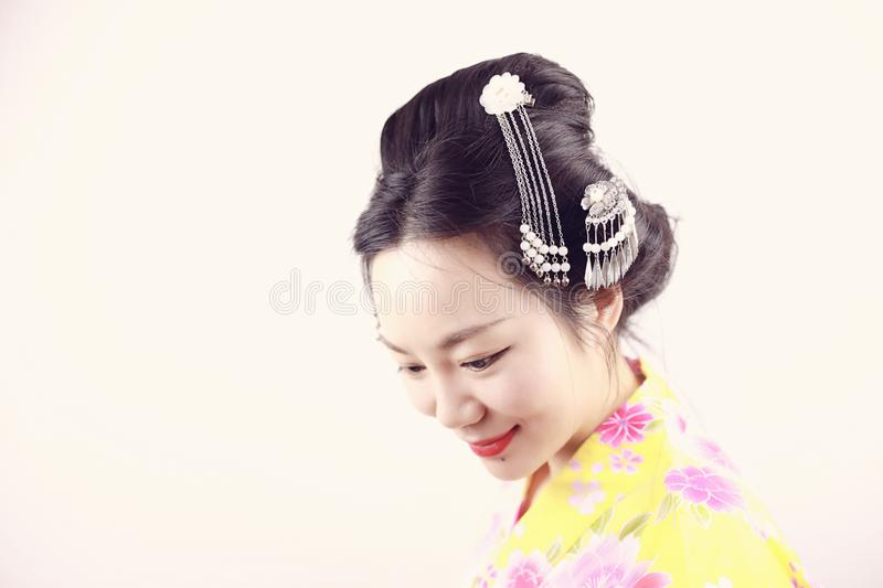 Traditional Asian Japanese beautiful Geisha woman wears kimono smile on a isolated white background. Japanese woman with kimono Japanese bride smiling stand by royalty free stock image