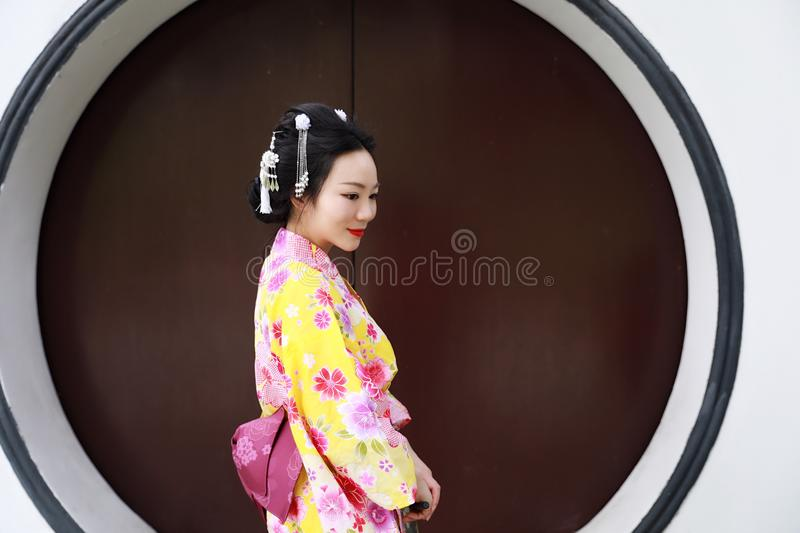 Traditional Asian Japanese beautiful Geisha woman wears kimono in a summer nature. Japanese woman with kimono Japanese bride smiling stand by bamboo in a spring stock image