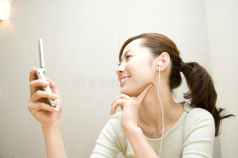 Download Japanese Woman Listening To The Music Royalty Free Stock Photo - Image: 10127305
