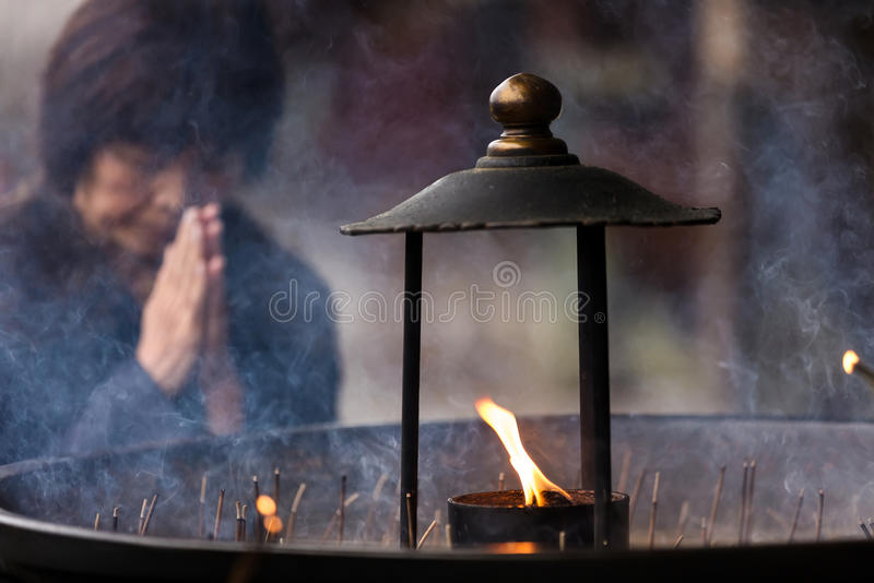 Japanese woman praying royalty free stock photography