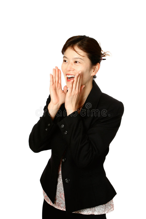 Japanese woman shouting. Young Japanese businesswoman in gesture of shouting out loud, smartly attired, isolated on white stock image