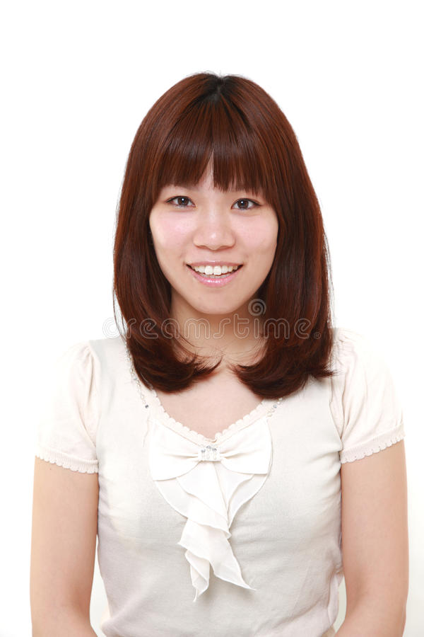 Japanese woman smiles. Studio shot of young Japanese woman on white background stock images