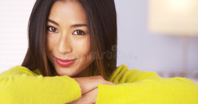 Japanese woman smiling and looking at camera stock images