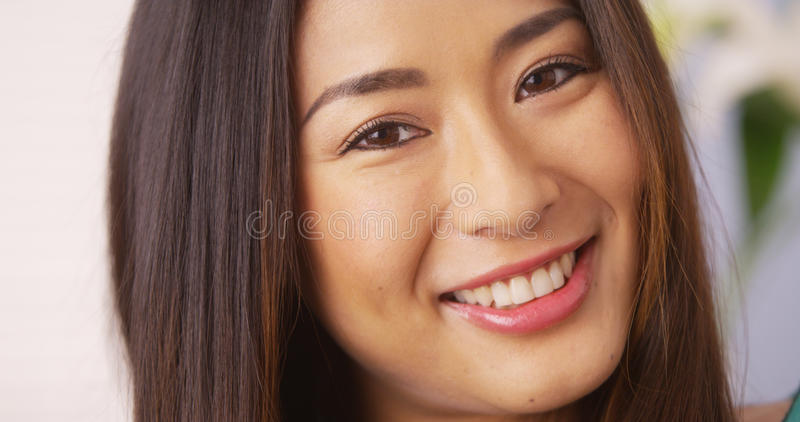Japanese woman smiling and looking at camera stock photography