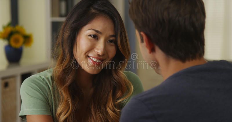 Japanese woman smiling and talking to boyfriend stock photos