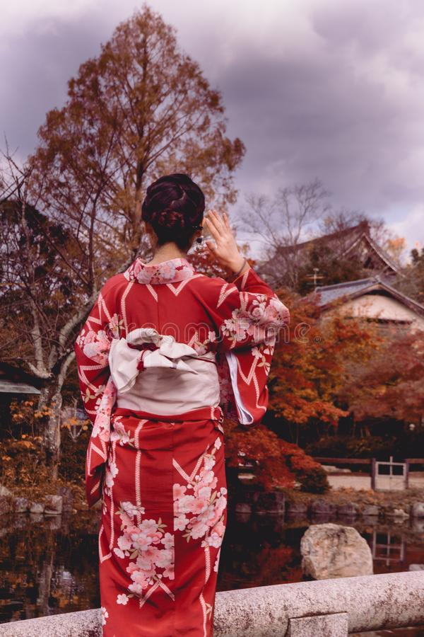 A japanese woman wearing a kimono stock images