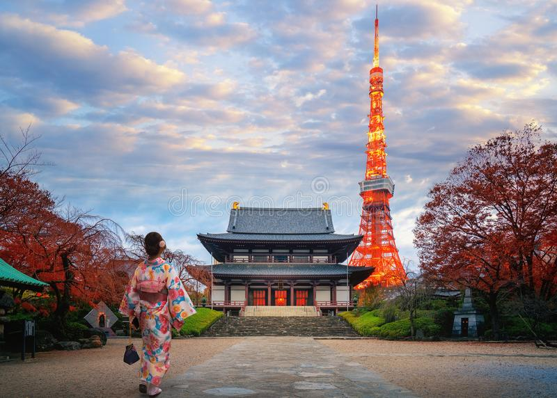 Japanese women in kimono dress walk in Zojoji temple. Japanese woman in kimono dress walk in Zojoji temple in Tokyo city with Tokyo tower background, Japan, Asia royalty free stock photo