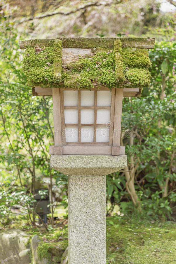 Japanese wooden lantern. In garden stock photography