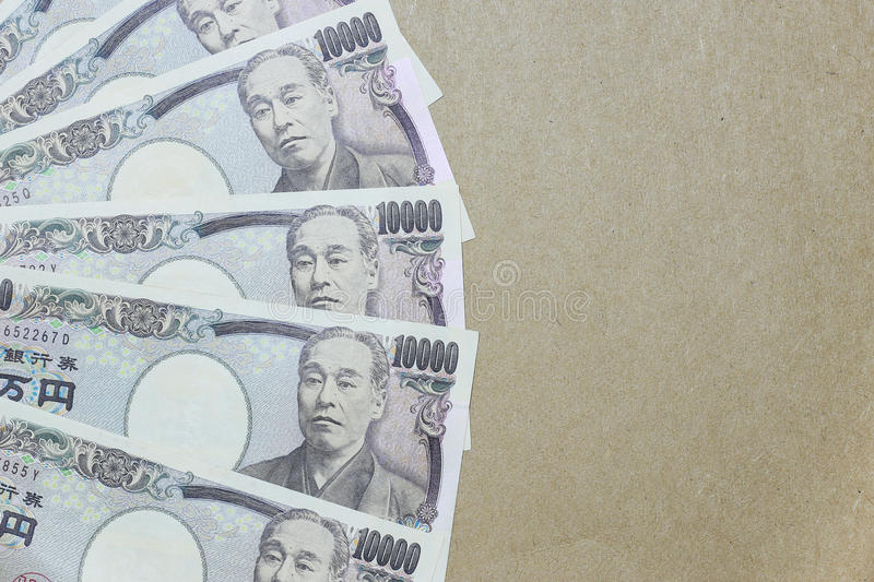 Japanese yen on brown paper background royalty free stock images