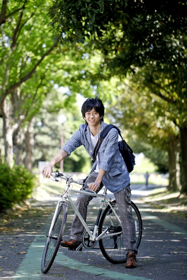 japanese young men bicycle university students university campus image japanese young man bicycle college student 165508454