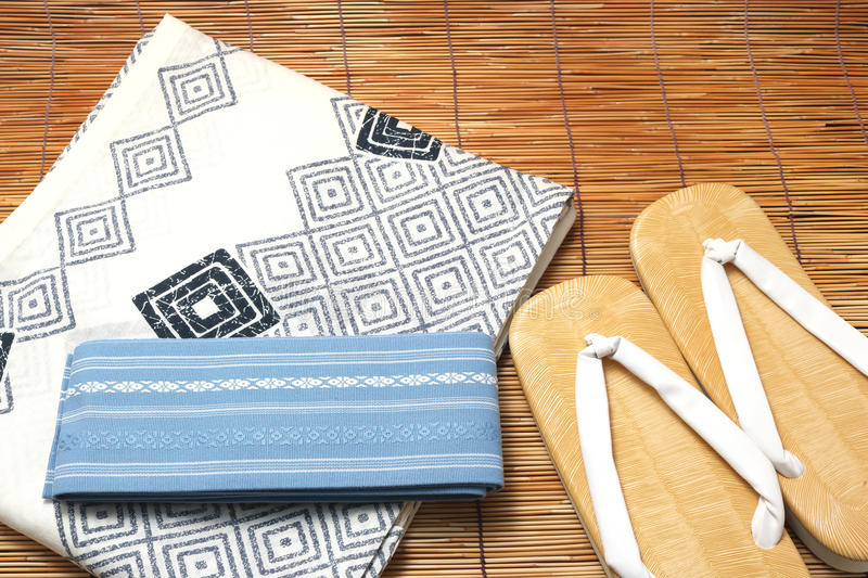 Japanese yukata and a band for men on bamboo blinds. Concept of Japanese summer stock photo