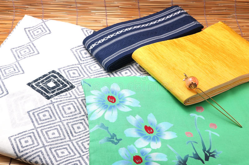 Japanese yukata and a band for men and women on bamboo blinds. Concept of Japanese summer royalty free stock photography