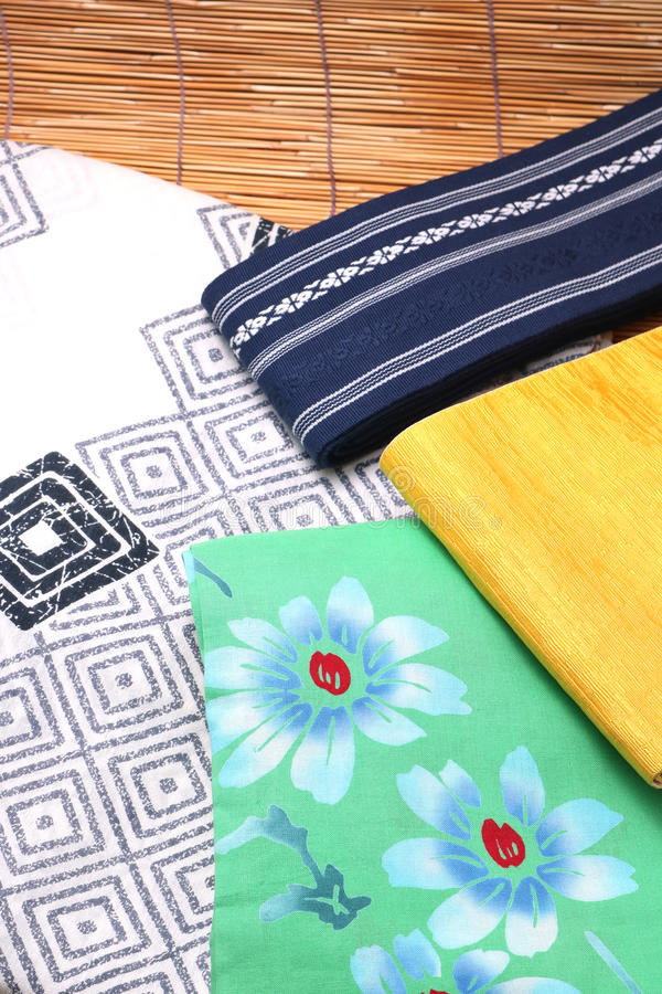 Japanese yukata and a band for men and women on bamboo blinds. Concept of Japanese summer stock images