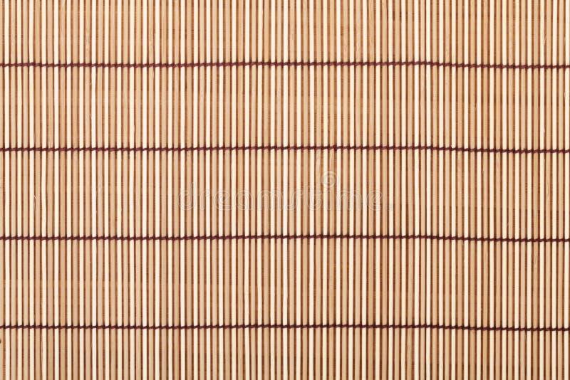 Japanische kochende Matte über Bambustabelle stockbild