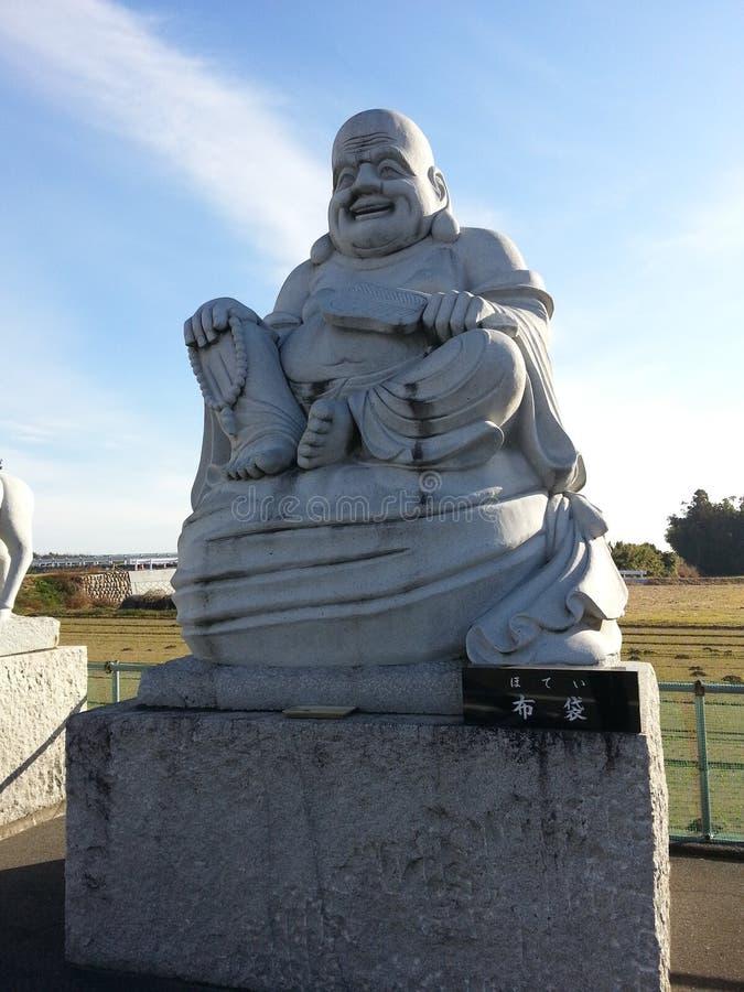 Japanische Statue von Hotei-Gott stockbilder