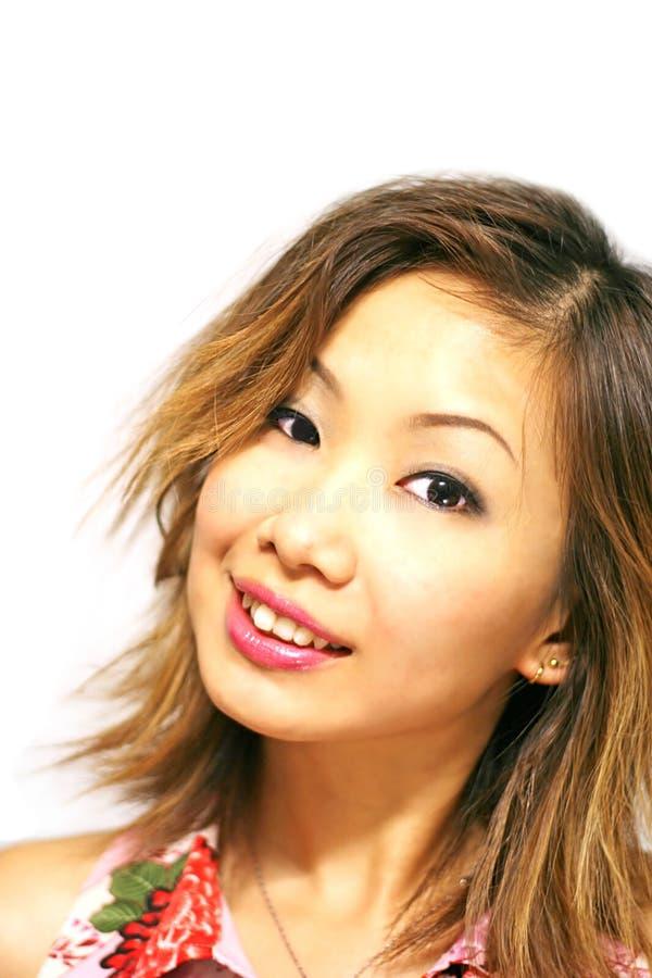 Japanisches Mädchen-Lächeln stockfotos