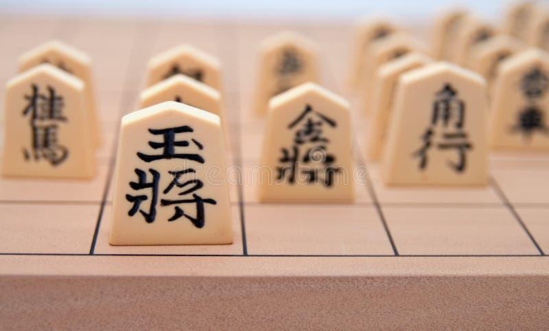 Japanisches Thema des Schach-Set-(Shogi): Führung stockbild