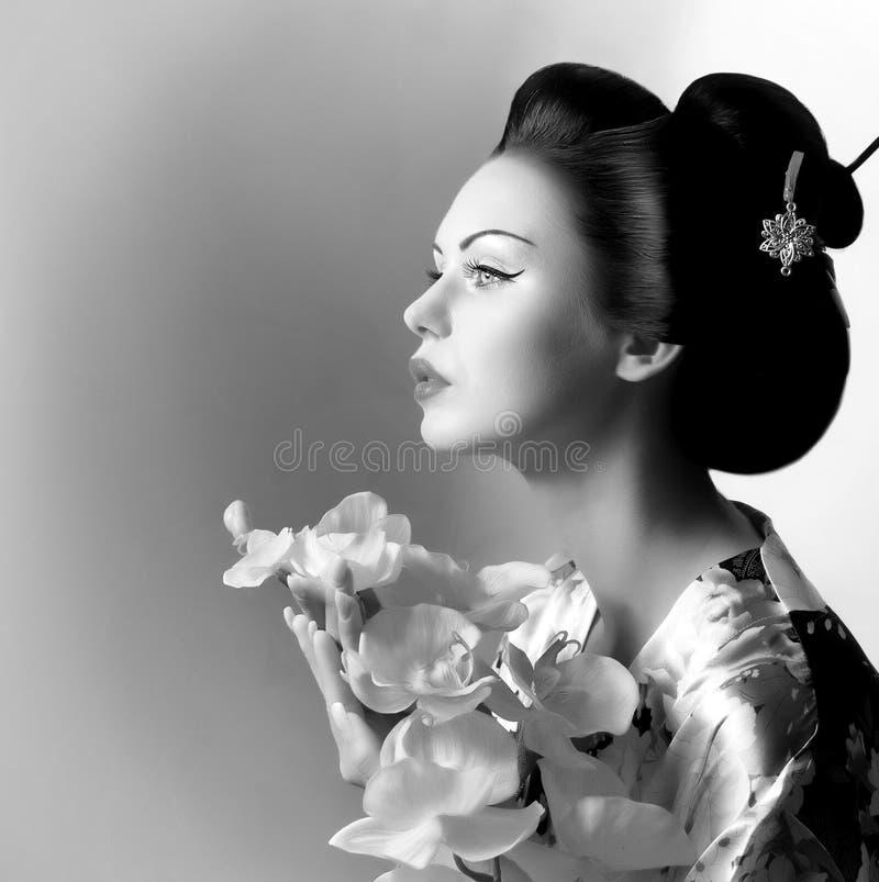 Japanse geishavrouw stock afbeeldingen