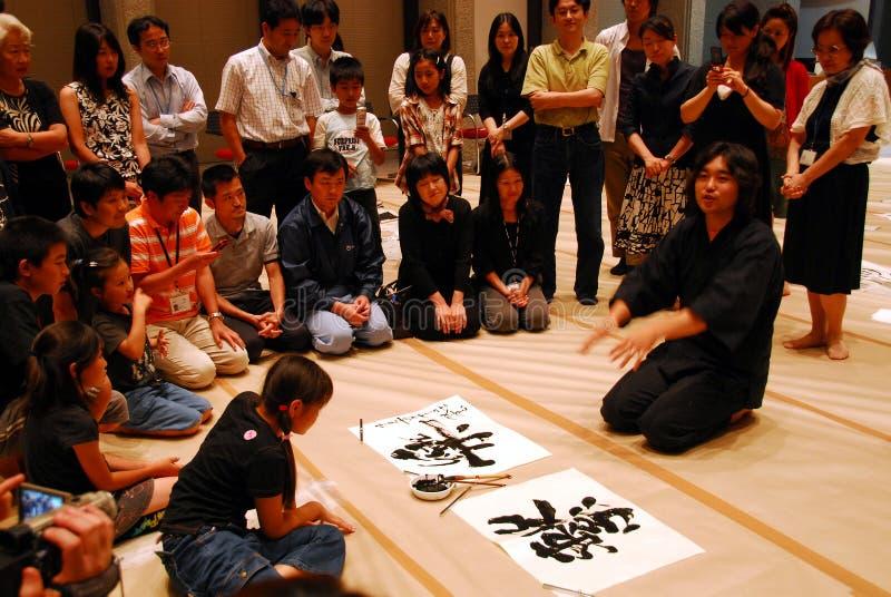 Japanse kalligrafieleraar stock afbeeldingen