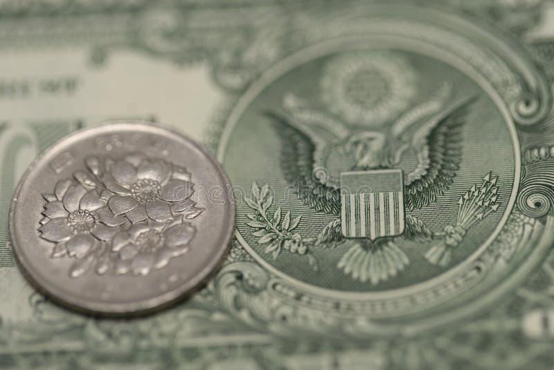 Japanse Yen en Amerikaanse dollar stock fotografie