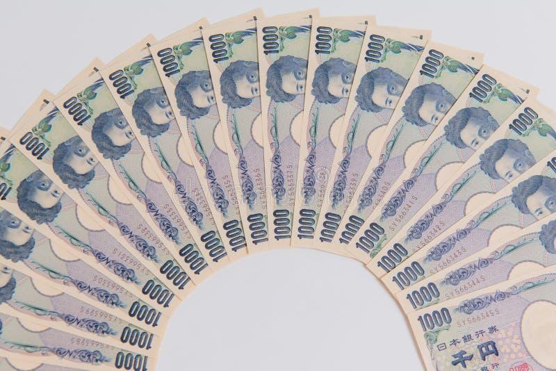Japanse Yen, 1000 Yen op witte achtergrond, de Japanse bank van de muntyen stock afbeelding