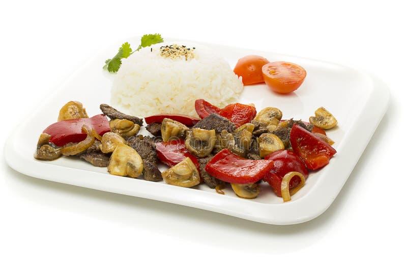 Japansk kokkonst - ris med kött och champinjoner och grönsaker royaltyfri bild